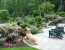 Wooded-area-perfect-for-the-deep-natural-landscaping-backyard-design-with-the-white-stone-paver-for-the-outdoor-patio-with-cool-pool
