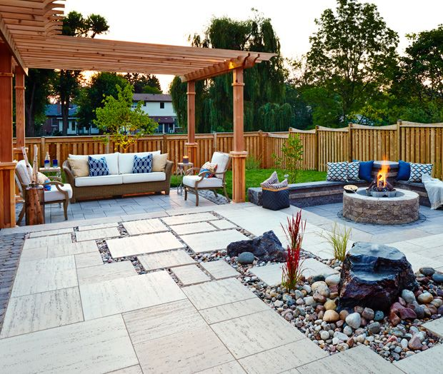 there are numerous ideas that you can use to enhance the design of your backyard patio a treasure garden umbrella on top of a table keeps the sun from - Backyard Patio